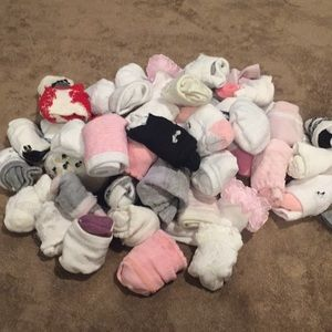 Over 45 pair of baby girl socks